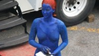 EXCLUSIVE: Jennifer Lawrence, who plays Mystique, on the set of the movie 'X-Men: Days of Future Past' in Montreal. She is spotted changing herself in her make-up trailer. Also, she's having fun talking and making funny faces to Nicholas Hoult on her break. Her bodyguard hides her with an umbrella when they left the base camp. Pictured: Jennifer Lawrence Ref: SPL552672  310513   EXCLUSIVE Picture by: Ultrawig / Splash News Splash News and Pictures Los Angeles:	310-821-2666 New York:	212-619-2666 London:	870-934-2666 photodesk@splashnews.com